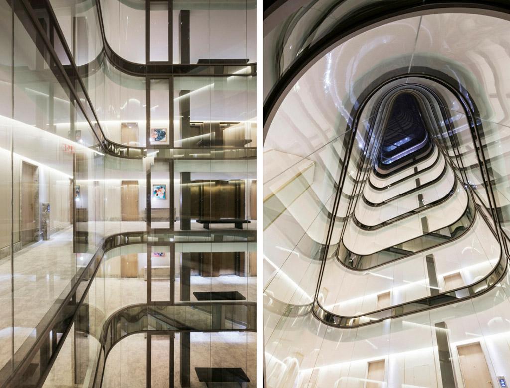 Au centre de l'immeuble, une spectaculaire façade de verre incurvée joue le rôle de puits de lumière