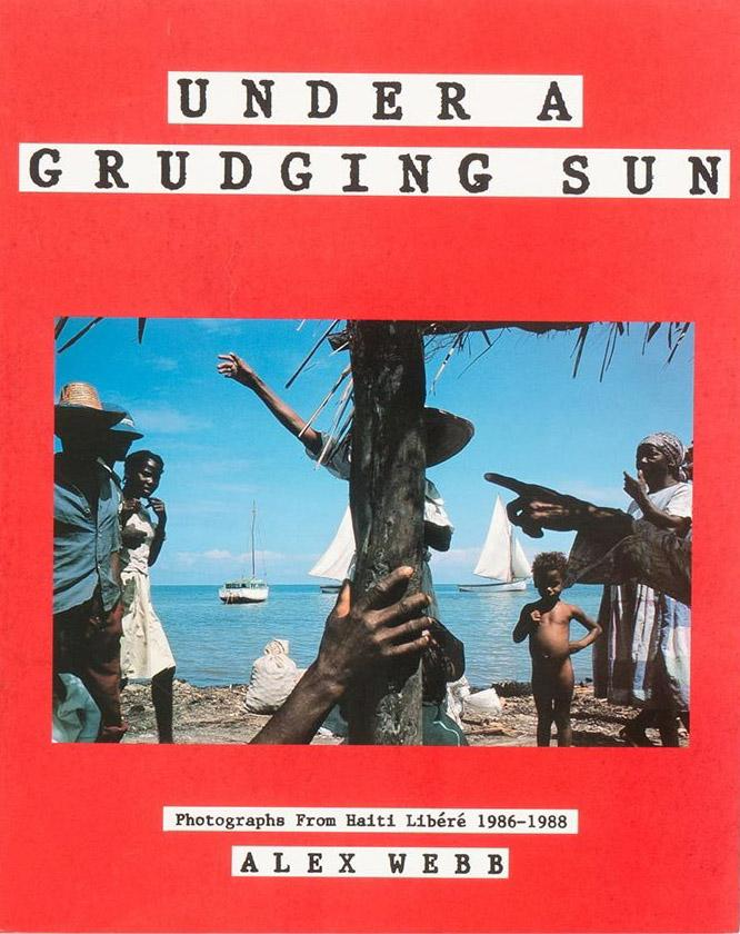 <em>Under a Grudging Sun: Photographs from Haiti libéré 1986-1988. </em>Thames & Hudson, 1989.