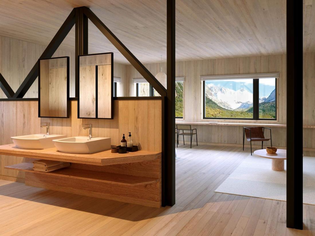 Les murs et le mobilier en bois renforcent l'atmosphère chaleureuse des chambres