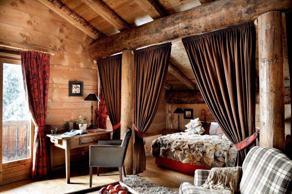 Les chambres tout en bois et tissus chaleureux, ode à la montagne. © Les Fermes de Marie / L. Di Orio, MPM, T. Shu et DR