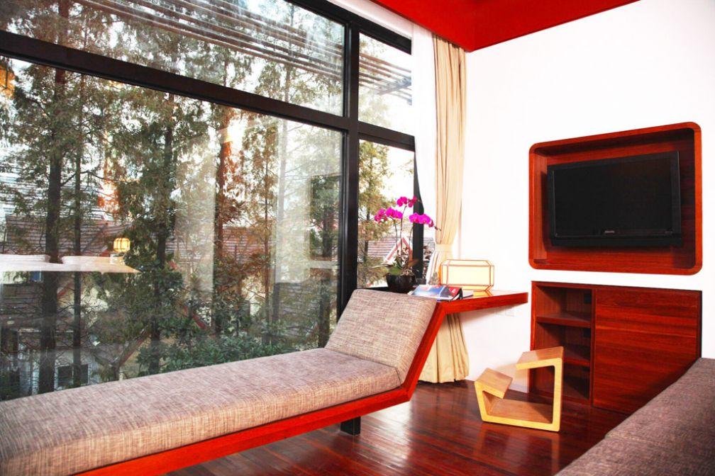 Vue sur le jardin de l'hôtel depuis une chambre Executive Garden View © URBN