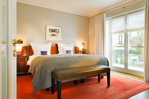 La chambre à coucher de la chambre 165 © Hotel Louis C. Jacob
