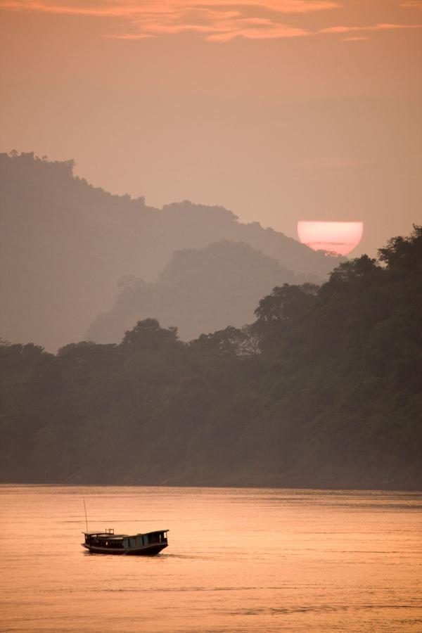 Croisière sur le Mékong au coucher de soleil © Aman