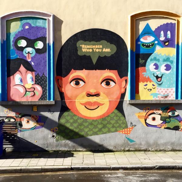 Fresque street art signée Bué, sur le mux extérieur de De Superette © Yonder.fr